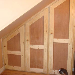 Bespoke Cupboards Under Angled Roofing