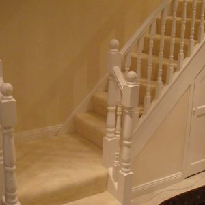 White banister bottom step