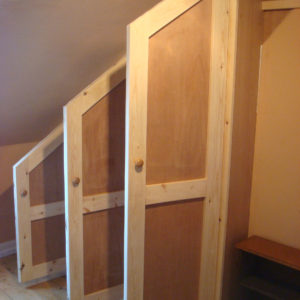 Custom wardrobe for sloping roof